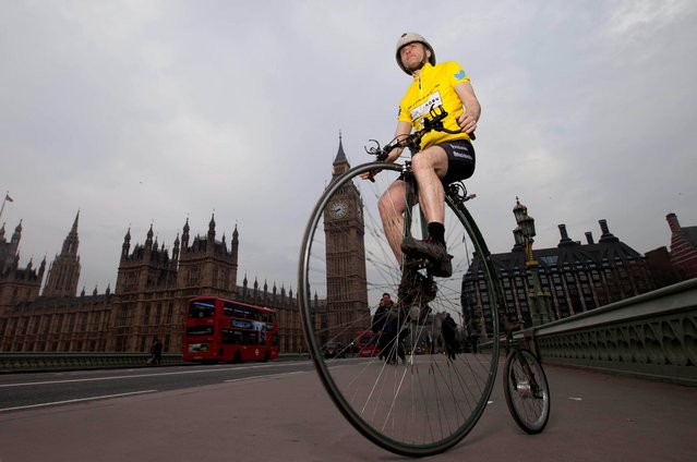 Joff Summerfield, from Greenwich in south east London, rides his penny farthing across Westminster Bridge in central London on April 2, 2014, during his training ahead of taking part in this year's Spring Classics, to celebrate the Tour de France coming to London on 7th July. The Spring Classics include the Tour of Flanders in Belgium and Paris-Roubaix in France. (Photo by David Parry/PA Wire)