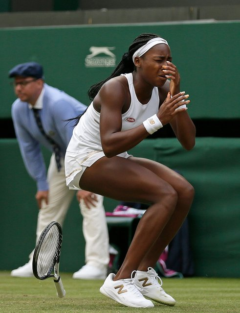 """United States' Cori """"Coco"""" Gauff reacts after beating United States's Venus Williams in a Women's singles match during day one of the Wimbledon Tennis Championships in London, Monday, July 1, 2019. (Photo by Tim Ireland/AP Photo)"""