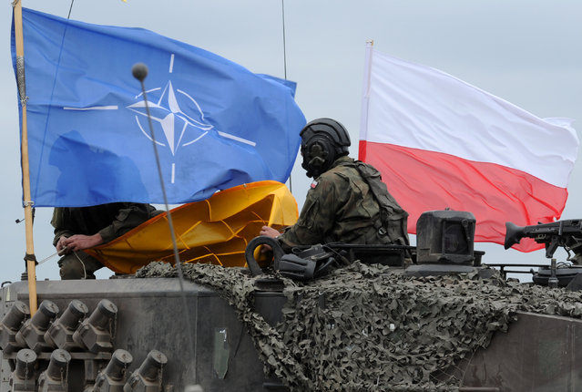 Polish Army soldiers check their tank after the NATO Noble Jump exercise on a training range near Swietoszow Zagan, Poland, Thursday, June 18, 2015. (AP Photo/Alik Keplicz)