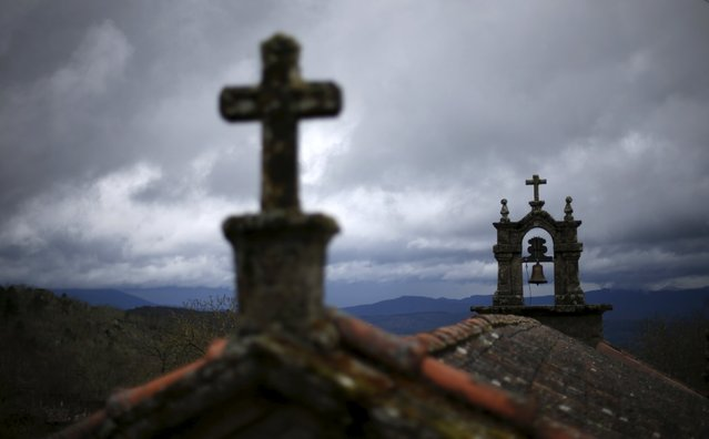 The bell tower of the church is seen in Povoa de Agracoes near Chaves, Portugal, April 19, 2016. (Photo by Rafael Marchante/Reuters)