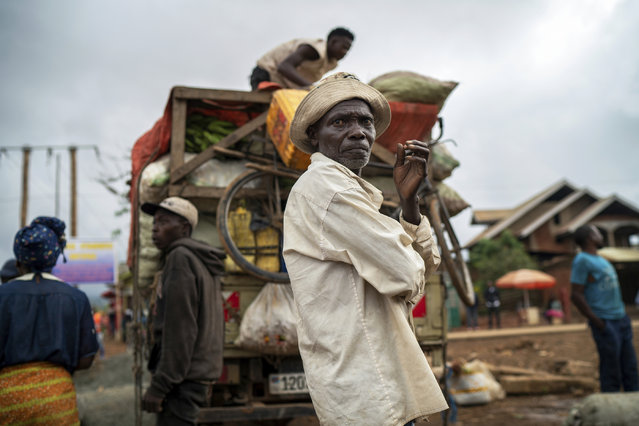 In this Thursday, July 11, 2019 photo, travelers unload goods from a truck they rode into Beni, Congo, the epicenter of the current Ebola epidemic. Deep distrust and pernicious rumors – along with political instability and violence – are severely undermining efforts by public health authorities to trace and vaccinate those who may have come into contact with infected people. (Photo by Jerome Delay/AP Photo)