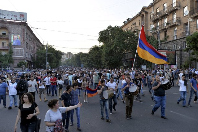 Protesters march during a rally against a hike in electricity prices in Yerevan, Armenia, June 28, 2015. Armenia's president tried to ease days of tension by suspending an increase in public electricity bills, pending a review of the decision, but failed to end a protest by thousands of people. (Photo by Karo Sahakyan/Reuters/PAN Photo)