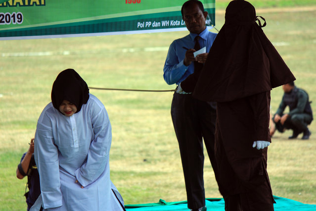 A woman is caned at a stadium in Lhokseumawe in Aceh province on July 31, 2019, after she was caught having pre-marital s*x. Two men and a woman were publicly whipped 100 times each for breaking Islamic law in Indonesia's conservative province Aceh. (Photo by The Mega Agency)