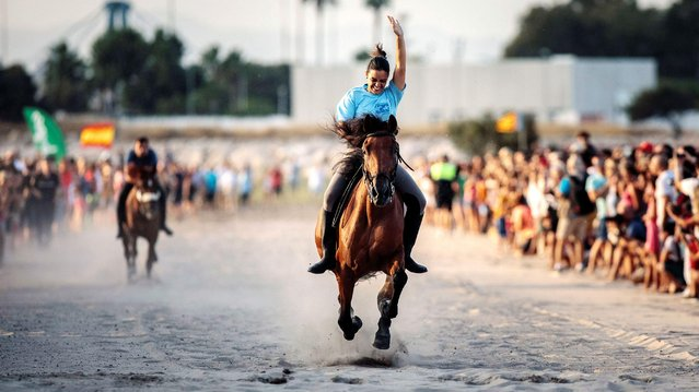 """A rider in action during th traditional """"Corregudes de Joies"""" horse riding beach race at the Pinedo beach in Pinedo, Valencia, Spain, 12 August 2019. (Photo by Biel Alino/EPA/EFE)"""