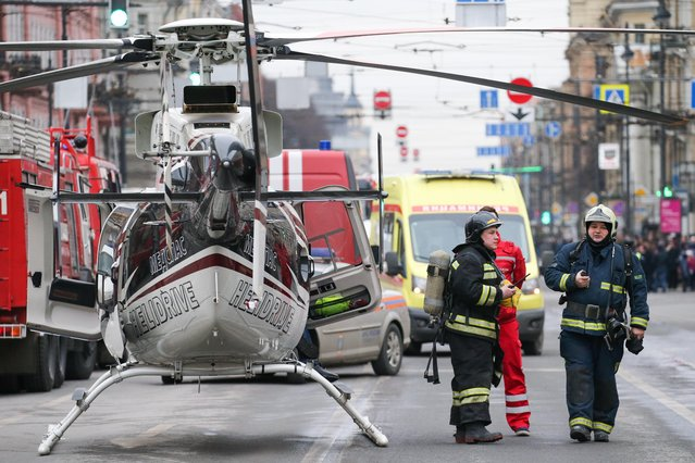 Fire fighters, emergency service vehicles and a helicopter in Moskovsky Prospekt at the entrance to Tekhnologichesky Institut station of the St Petersburg metro in the aftermath of an explosion which occurred in a train at 14:40 Moscow timeon April 3, 2017. (Photo by Peter Kovalev/TASS)