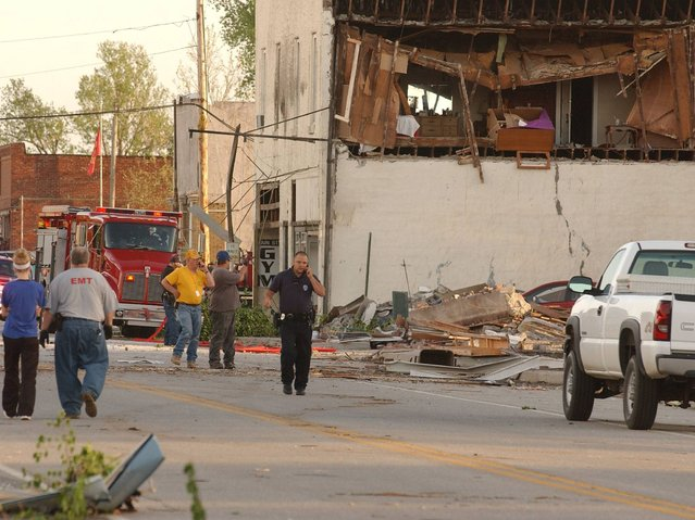 First responders, volunteers and firemen gather on Main Street in Quapaw after a tornado struck the city. (Photo by Gary Crow/AP Photo/Tulsa World)