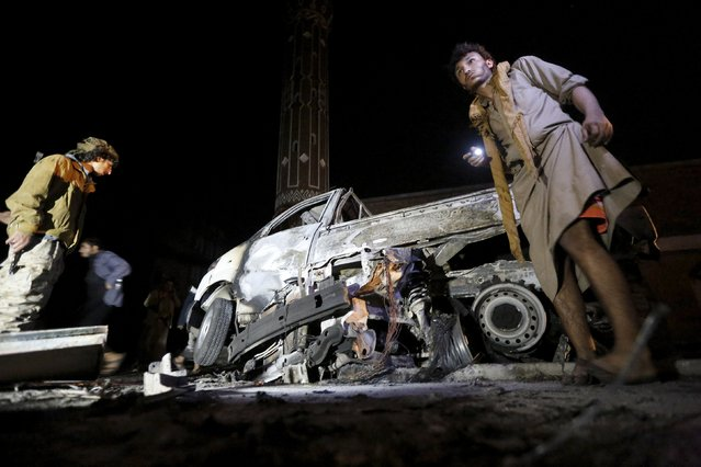 Houthi militants stand by at a truck destroyed by a car bomb attack near a mosque in Yemen's capital Sanaa July 7, 2015. Two deadly car bombs hit the capital Sanaa and a southern city in Yemen on Tuesday, state news agency Saba reported, a day after air strike and clashes killed almost 200 people nationwide. (Photo by Khaled Abdullah/Reuters)