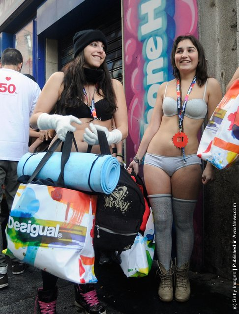 Semi-nude shoppers queue for free clothes during a promotion by a Spanish clothes outlet on January in Madrid