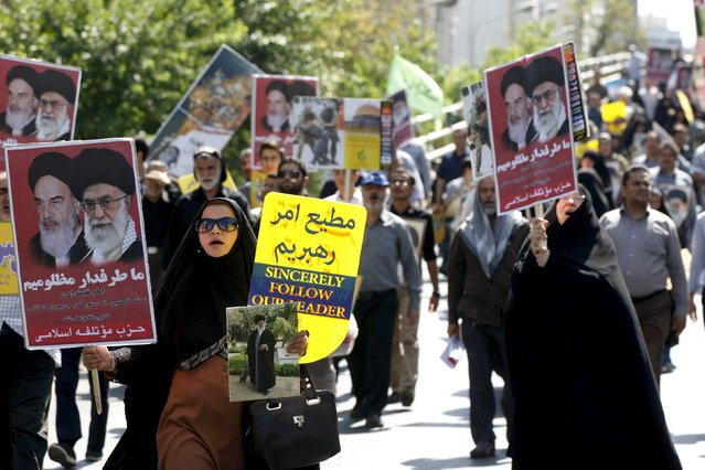 Iranian demonstrators carry posters depicting Iran's Supreme Leader Ayatollah Ali Khamenei and late Iranian leader Ayatollah Khomeini during a rally marking al-Quds (Jerusalem) Day in Tehran July 10, 2015. (Photo by Reuters/Stringer/TIMA)