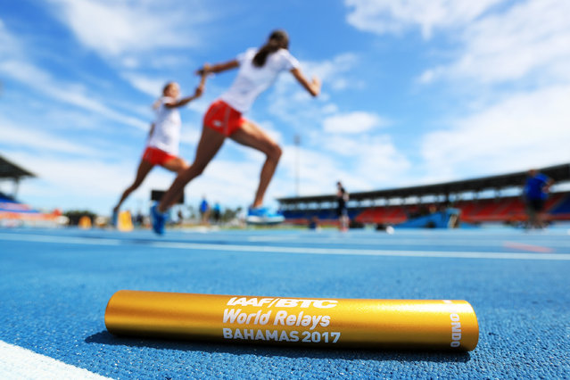 A baton is displayed in the foreground as athletes practice prior to the IAAF / BTC World Relays Bahamas 2017 at the Thomas Robinson Stadium on April 21, 2017 in Nassau, Bahamas. (Photo by Matthew Lewis/Getty Images for IAAF )