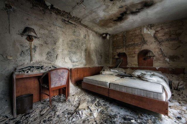 This hotel in Germany has been abandoned since a fire in 2012. The complete interior is still there, but because of the weather conditions in this area, decay happens fast. (Photo by Vincent Jansen)