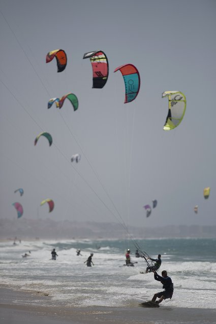 Kite surfers take part in the Tarifa Kitesurfing World Championships 2015 at Los Lances beach, near Tarifa on July 11, 2015. (Photo by Jorge Guerrero/AFP Photo)