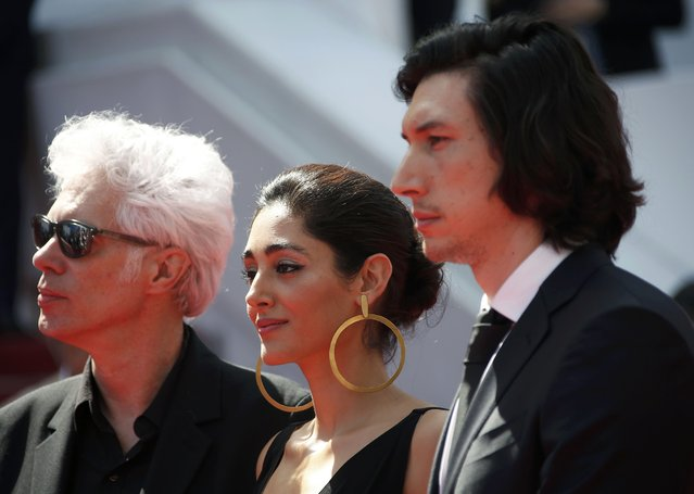 """Director Jim Jarmusch (L), cast members Adam Driver (R) and Golshifteh Farahani pose on the red carpet before the screening of  the film """"Paterson"""" in competition at the 69th Cannes Film Festival in Cannes, France, May 16, 2016. (Photo by Eric Gaillard/Reuters)"""