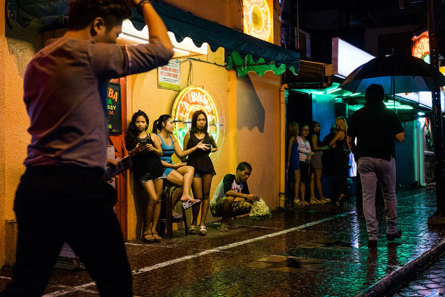 A scene from Fields Avenue, the red light district in Angeles City. (Photo by Hannah Reyes Morales/The Washington Post)
