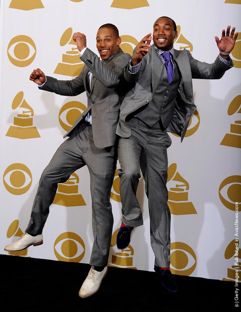 (L-R) NFL players Victor Cruz and Mario Manningham of the New York Giants pose in the press room at the 54th Annual GRAMMY Awards