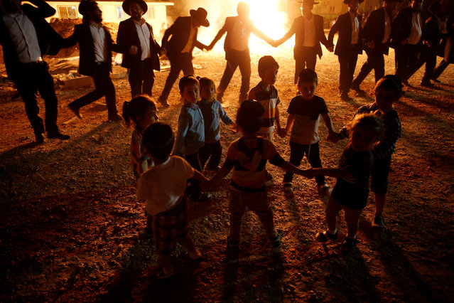 Ultra-Orthodox Jewish boys dance near a bonfire as they celebrate the Jewish holiday of Lag Ba'Omer in the city of Ashdod, Israel May 25, 2016. (Photo by Amir Cohen/Reuters)