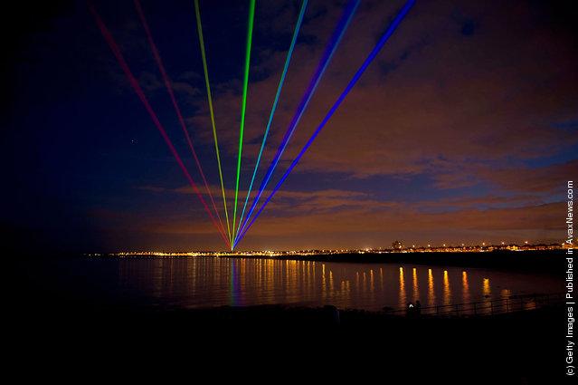 International artist Yvette Mattern shows her stunning laser rainbow projection, Global Rainbow