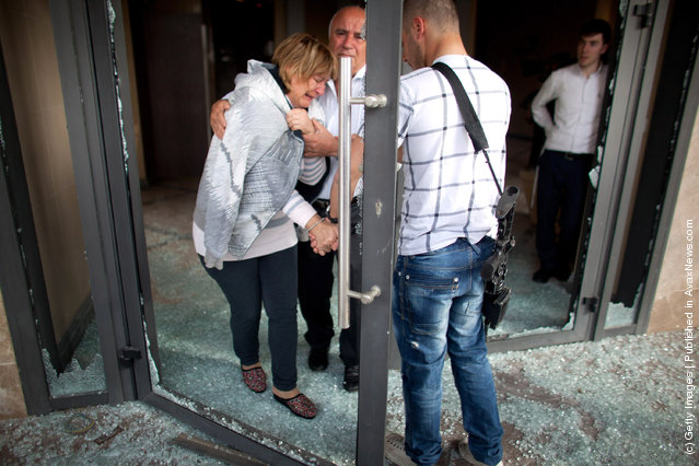 An Israeli woman is evacuated following a rocket attack from the nearby Gaza Strip