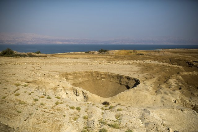 A sinkhole is seen on the shore of the Dead Sea, Israel July 27, 2015. (Photo by Amir Cohen/Reuters)