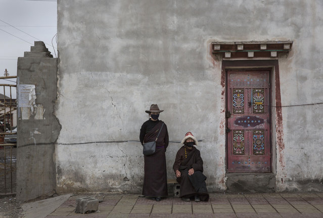 Tibetan nomads wait to buy cordycep fungus at a market on May 22, 2016 on the Tibetan Plateau near Sershul in the Garze Tibetan Autonomous Prefecture of Sichuan province. (Photo by Kevin Frayer/Getty Images)