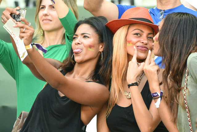 Ghanaian fans take a selfie prior to a Group G football match between Germany and Ghana at the Castelao Stadium in Fortaleza during the 2014 FIFA World Cup on June 21, 2014. (Photo by Patrik Stollarz/AFP Photo)