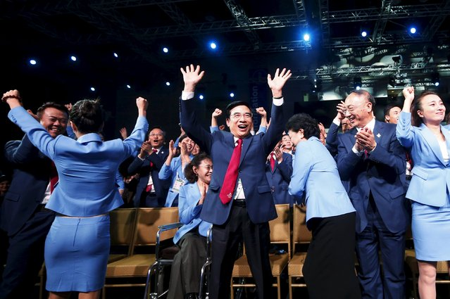Beijing's Mayor and President of the Beijing 2022 delegation Wang Anshun (C) celebrates after Beijing was awarded the 2022 Winter Olympic Games, defeating Almaty in the final round of voting, during the 128th IOC session in Kuala Lumpur, Malaysia, July 31, 2015. (Photo by Olivia Harris/Reuters)