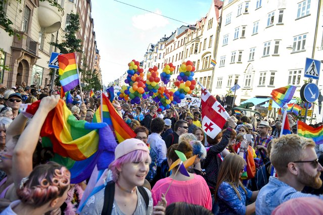 Participants attend the annual gay pride parade march in Stockholm, Sweden, August 1, 2015. (Photo by Vilhelm Stokstad/Reuters/TT News Agency)