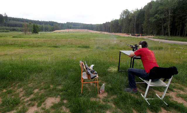 Jan Vurbs shoots his rifle at a forest shooting range near the village of Visnova, Czech Republic, June 9, 2016. (Photo by David W. Cerny/Reuters)