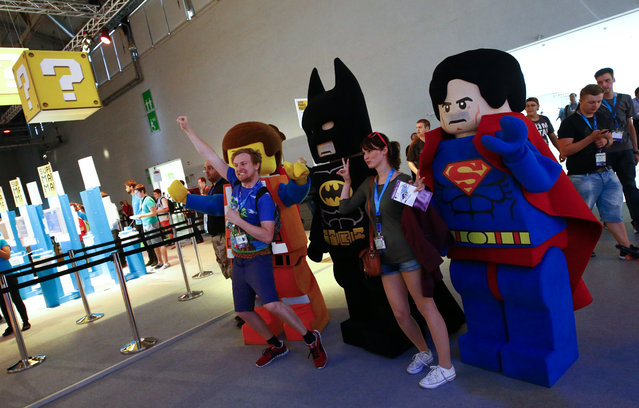 People pose in front of characters during the Gamescom 2015 fair in Cologne, Germany August 5, 2015. (Photo by Kai Pfaffenbach/Reuters)