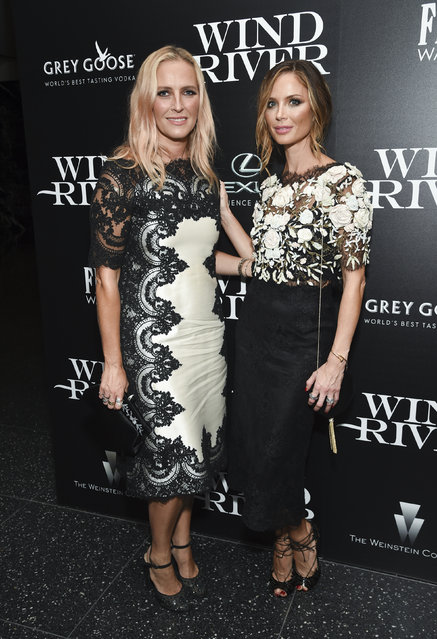 """Fashion designers Keren Craig, left, and Georgina Chapman attend a special screening of """"Wind River"""", hosted by The Weinstein Company with The Cinema Society, at the Museum of Modern Art on Wednesday, August 2, 2017, in New York. (Photo by Evan Agostini/Invision/AP Photo)"""