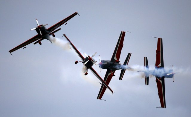 Airplanes from Royal Jordanian Falcons perform during the Radom Air Show at an airport in Radom, Poland August 23, 2015. (Photo by Kacper Pempel/Reuters)