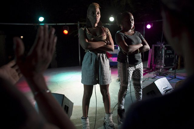 "Hiphop singers Reyna Hernandez (L), who has a degree in Chemistry, 29, and Social Worker Yadira Pintado, 29, who are known as ""La Reina y la Real"", or ""The Queen and the Real"" in Spanish, perform at a space dedicated to alternative arts in Havana, March 19, 2015. Picture taken March 19, 2015. (Photo by Alexandre Meneghini/Reuters)"