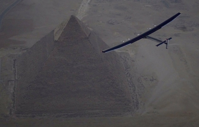Solar Impulse 2, the solar powered plane, piloted by Swiss pioneer Andre Borschberg is seen during the flyover of the pyramids of Giza on July 13, 2016 prior to the landing in Cairo, Egypt in this photo released on July 13, 2016. (Photo by Jean Revillard/Reuters/SI2)