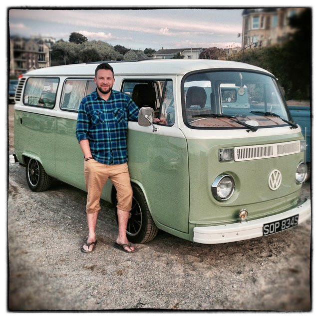 Simon Peacock, 34, from Stoke on Trent poses for a photograph besides his 1977 second generation or T2, bay window Volkswagen Transporter van in Newquay on August 7, 2014 in Cornwall, England. The van, which he bought for £2600 fourteen years ago was originally a panel van and is now worth roughly £14000. (Photo by Matt Cardy/Getty Images)