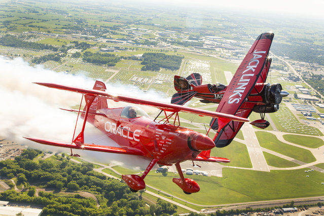 Renowned aerobatic pilots Sean D. Tucker, flying the Oracle Challenger III, and Jeff Boerboon, flying the Jack Link's Screamin' Sasquatch, take to the skies over EAA's 2015 AirVenture Oshkosh, on Monday, July 20, 2015 in Oshkosh, Wis. (Photo by Matt Ludtke/AP Images for Jack Link's)
