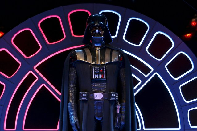 """The costume of character Darth Vader from the """"Star Wars"""" film series is displayed during press day for the exhibition """"Star Wars Identities"""" at the """"Cite du Cinema"""" movie studios in Saint-Denis, near Paris, France in this February 13, 2014 file photo. """"Star Wars"""" producers last Wednesday announced a marathon, worldwide roll-out of toys for its upcoming """"The Force Awakens"""" movie in a promotional push that seeks to capture the excitement that once greeted new """"Harry Potter"""" book releases. (Photo by Benoit Tessier/Reuters)"""
