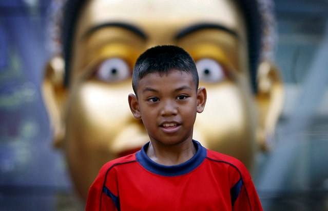 A young anti-government protester listens to speeches at a camp in a main commercial shopping district causing shops and businesses to close down where they have occupied for more than a week in Bangkok, Thailand on Sunday April 11, 2010 in Bangkok, Thailand. (Photo by Wong Maye-E/AP Photo)