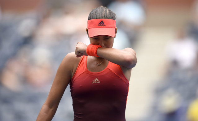 Ana Ivanovic of Serbia reacts as she plays Dominika Cibulkova of Slovakia during their match on the first day of the 2015 US Open Tennis Championship at the USTA National Tennis Center in Flushing Meadows, New York, USA, 31 August 2015. The US Open runs through 13 September, which is a return to a 14-day schedule. (Photo by John G. Mabanglo/EPA)