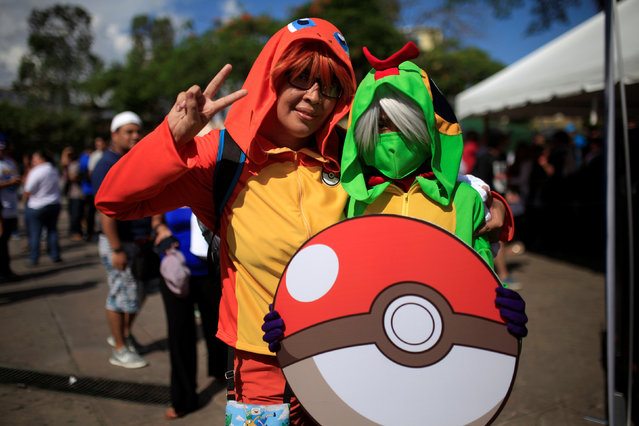 """Cosplayers dressed as characters of the augmented reality mobile game """"Pokemon Go"""" by Nintendo participate in a """"poketour"""" organized by the municipality in San Salvador, El Salvador July 23, 2016. (Photo by Jose Cabezas/Reuters)"""