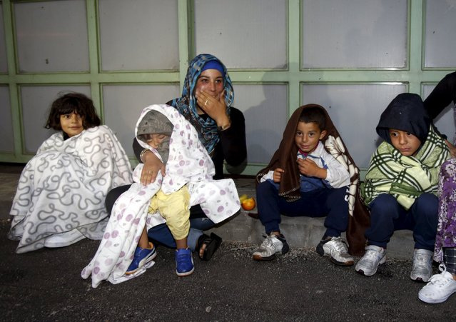 Migrants sit at the Austrian-Hungarian border station of Hegyeshalom, Hungary, September 5, 2015. (Photo by Heinz-Peter Bader/Reuters)