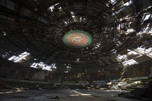 A general view shows the crumbling main hall of the Memorial House of the Bulgarian Communist Party on mount Buzludzha September 12, 2014. (Photo by Stoyan Nenov/Reuters)