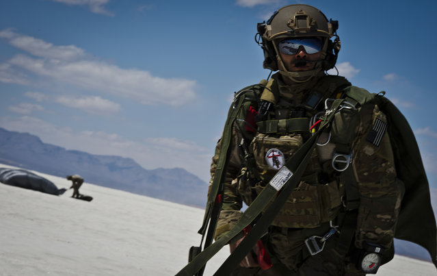 Senior Airman Pedro Rodriguez, a combat controller with the 22nd Special Tactics Squadron out of Joint Base Lewis-McChord, Wash., watches as other members of his team land after parachuting 13,000 feet for training. A combat controller's mission is to deploy undetected into combat and hostile environments to conduct special reconnaissance, establish assault zones or airfields, while simultaneously conducting air traffic control, fire support, command, control, and communications and forward air control. (Photo by Senior Airman Andrew Lee/U.S. Air Force photo)