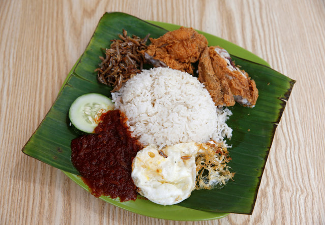 A plate of $2.60 nasi lemak is seen at Changi Famous Nasi Lemak at Changi Village Food Center in Singapore July 30, 2016. (Photo by Edgar Su/Reuters)