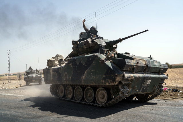 Turkish troops head to the Syrian border, in Karkamis, Turkey, Saturday, August 27, 2016. Turkey on Wednesday sent tanks across the border to help Syrian rebels retake the key Islamic State-held town of Jarablus and to contain the expansion of Syria's Kurds in an area bordering Turkey. (Photo by Halit Onur Sandal/AP Photo)