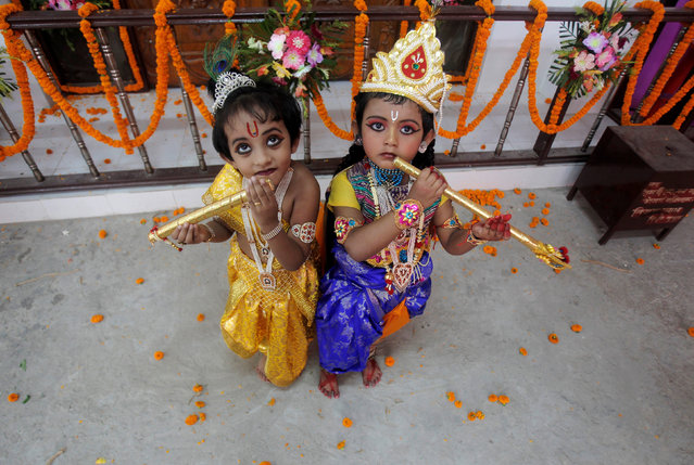 Children dressed up as Hindu Lord Krishna pose during Janmashtami festival celebrations marking the birth anniversary of Krishna in Agartala, India August 24, 2016. (Photo by Jayanta Dey/Reuters)