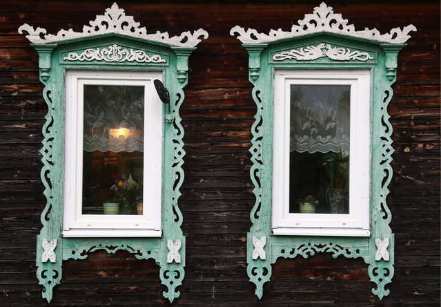 Traditional Russian wooden window frames in the town of Rostov in Yaroslavl Region, Russia on July 17, 2020. (Photo by Valery Sharifulin/TASS)