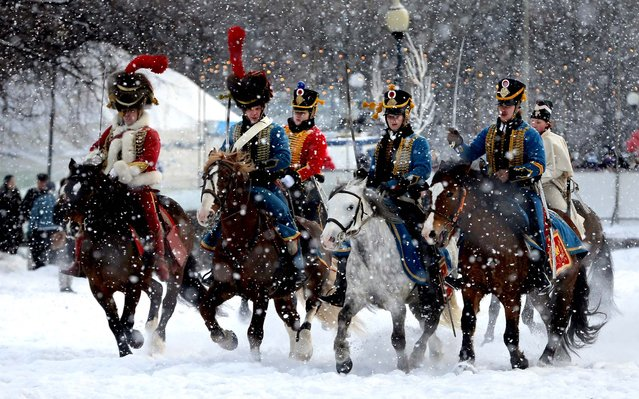 Historical re-enactors dressed as 1812-era French horsemen ride during a reenactment of the French Invasion of Russia in 1812, during celebrations to mark the Russian Orthodox Christmas in St. Petersburg, Russia, on January 7, 2013. Christmas falls on January 7 for Orthodox Christians who rely on the old Julian calendar rather than the  Gregorian calendar adopted by Catholics and Protestants and commonly used in secular life around the world. (Photo by Dmitry Lovetsky/Associated Press)