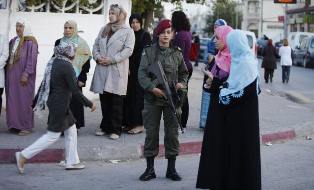 People stand in line at a polling station as they wait to cast their votes, in Tunis October 26, 2014. Tunisians voted on Sunday in parliamentary elections that bring full democracy finally within their reach, four years after their revolution cast out autocrat Zine El-Abidine Ben Ali. (Photo by Zoubeir Souissi/Reuters)
