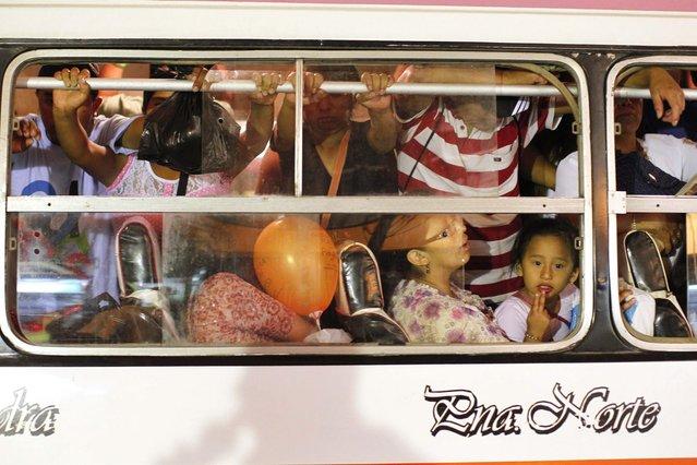 Passengers ride a packed public bus in downtown Lima, March 15, 2014. (Photo by Enrique Castro-Mendivil/Reuters)