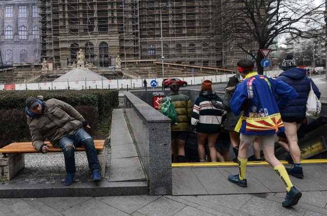 """Passengers without pants walk in a subway station during the """"No Pants Subway Ride"""" on January 7, 2018 in Prague. (Photo by Michal Cizek/AFP Photo)"""